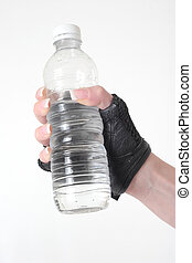 Hand holding a bottle of water