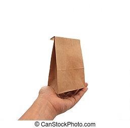 hand holding a brown paper bag