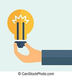 Hand holding a bulb.