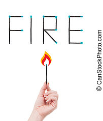 Fire hazard concept - Hand holding a burning match and word ...