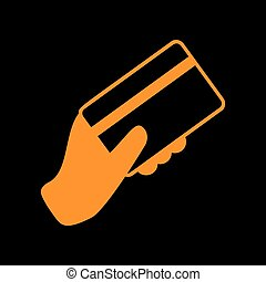 Hand holding a credit card. Orange icon on black background. Old phosphor monitor. CRT.