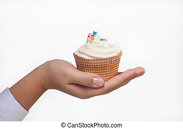 hand holding a cupcake isolated on white