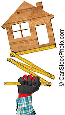 Hand Holding a Folding Ruler and a House