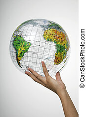 Hand holding a globe - Hands holding a globe on white...