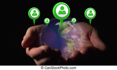 Hand holding a globe with profile icons on map pins