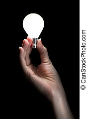 Hand holding a glowing light bulb