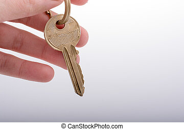 Hand holding a golden color key
