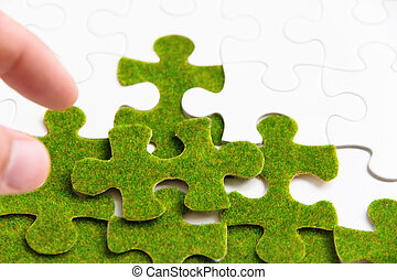 green puzzle piece, green concept