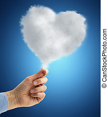 hand holding a heart-shaped cloud - male hand holding a...