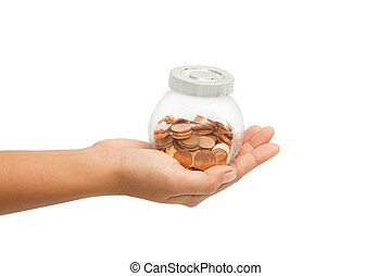 Hand holding a jar of money for retirement