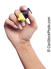 Hand holding a marker like writing