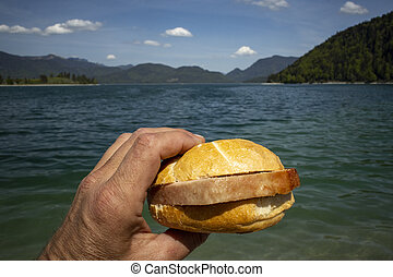 hand holding a meat loaf bun at Walchensee