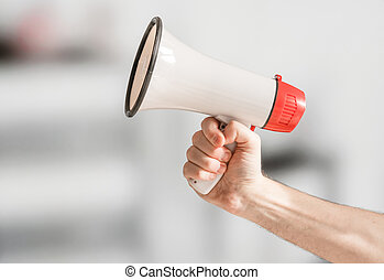 Hand holding a megaphone