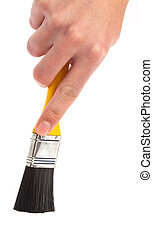 hand holding a paintbrush