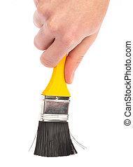 hand holding a paintbrush