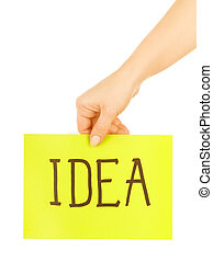 "hand holding a paper with the word ""idea"""