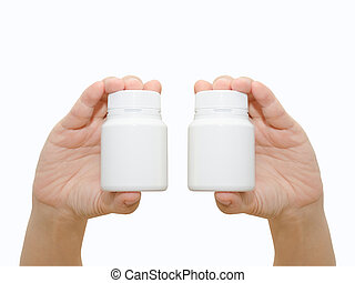 Hand holding a pill bottle isolated on white background