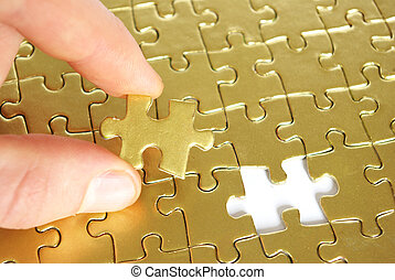 hand holding a puzzle piece . business concepts