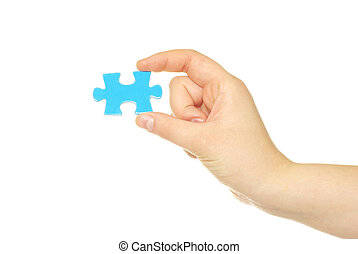 hand holding a puzzle