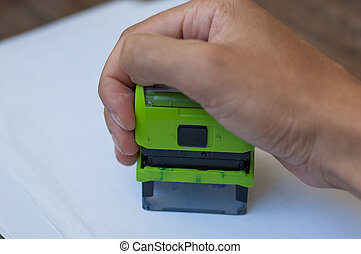 Hand holding a rubber stamp
