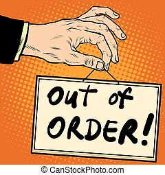 Hand holding a sign out of order