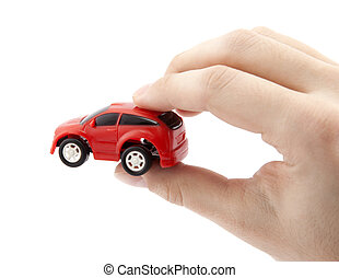 Hand holding a small red car