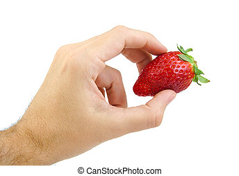 Hand holding a strawberry isolated on white.
