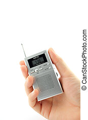 Hand with a battery powered radio. isolated on a white background.