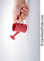 Hand holding a watering can on white background - Hand...
