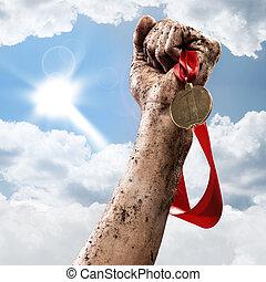 winner - hand holding a winner's medal, success in ...