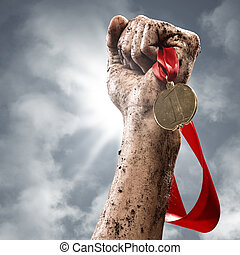 hand holding a winner's medal, success in competitions