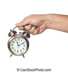Hand holding alarm clock on isolate