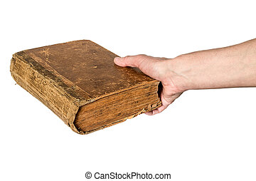 Hand holding an old book on white background