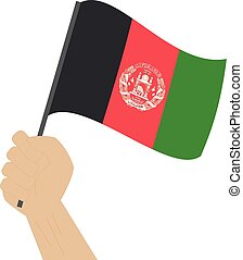 Hand holding and raising the national flag of Afghanistan