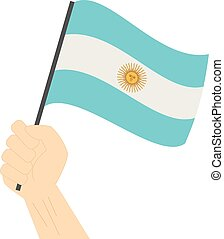 Hand holding and raising the national flag of Argentina