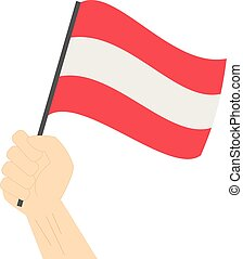 Hand holding and raising the national flag of Austria
