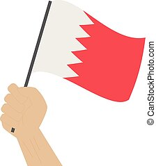 Hand holding and raising the national flag of Bahrain