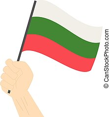 Hand holding and raising the national flag of Bulgaria