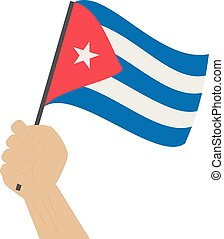Hand holding and raising the national flag of Cuba