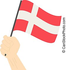 Hand holding and raising the national flag of Denmark
