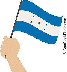 Hand holding and raising the national flag of Honduras