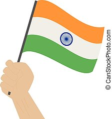 Hand holding and raising the national flag of India