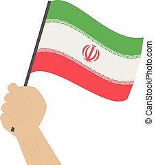Hand holding and raising the national flag of Iran