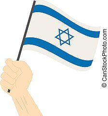 Hand holding and raising the national flag of Israel