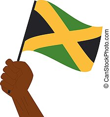 Hand holding and raising the national flag of Jamaica