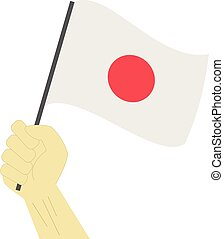 Hand holding and raising the national flag of Japan