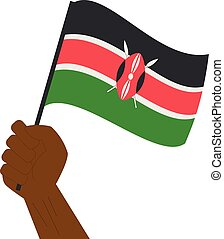 Hand holding and raising the national flag of Kenya