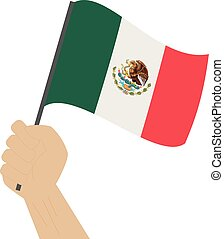 Hand holding and raising the national flag of Mexico