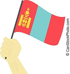 Hand holding and raising the national flag of Mongolia