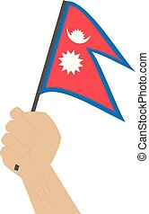Hand holding and raising the national flag of Nepal